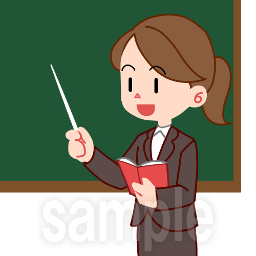 黒板の前に立つ教師(女)